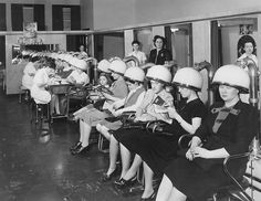 Women under hair dryers at Millie's Beauty Salon, 6310 North Western Avenue, Chicago, 1950 (the little girl hanging out between all the ladies is so cute). #vintage #hairdresser #hair #beauty
