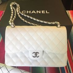 Authentic Chanel white caviar leather hand bag Authentic Chanel white caviar leather hand bag perfect condition worn ONCE no scratches  amazing elegant classic bag! Dust bag, card of authenticity and Chanel box comes with it! Original price over 6000!! Open to offers No PP Good vibes only!  CHANEL Bags Shoulder Bags