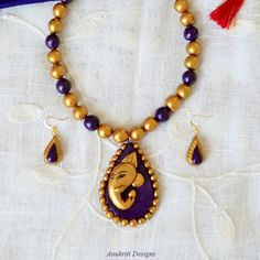 Items similar to Indian ethnic polymer clay jewelry - Terracotta Jewelry - Ganesh pendant set - Purple gold Ganesha Necklace - Jhumka on Etsy Terracotta Jewellery Making, Terracotta Jewellery Designs, Terracotta Earrings, Handmade Wire Jewelry, Funky Jewelry, Indian Wedding Jewelry, Indian Jewelry, Ethnic Jewelry, Ganesh Pendant