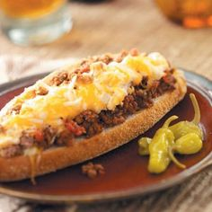 Here's an interesting way to serve a great main dish and enjoy several different cheeses. My family loves the meat sauce and cheese tucked into the hollowed-out buns. Add a crisp green salad for a complete meal. -Cindy Morelock, Afton, Tennessee