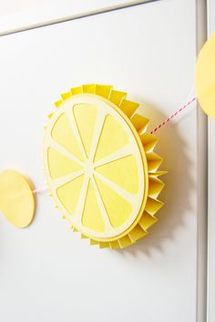 This lemon DIY rosette garland is such a perfect accent for your lemonade stand OR a fun addition to a summer tropical party! Farm Crafts, New Crafts, Crafts For Kids, Paper Crafts, Paper Fan Decorations, School Decorations, Diy Garland, Garland Decoration, Lemon Crafts