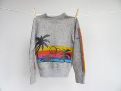 authentic heather grey kids sweatshirt with amazing geometric sunset graphic and the iconic OP logo. sleeves also have printed graphic