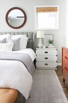 Adding Simple Touches of Easter Decor to your Home. This master bedroom has a few small touches of spring, like the bunny clock on the nightstand. It doesn't take much to inject some of the holiday into your home #springtouches #springdecor