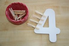 Big numbers and clip on the right # of clothes pins. Math and fine motor in one activity.