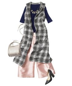 Be bold yet elegant in a classic plaid. Sure, you could stick with all black underneath, but icy pink and navy adds artsy flair.