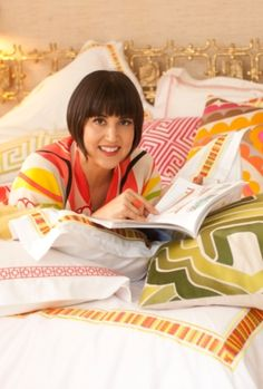 Look how cute she is with her pillows and comforter set!