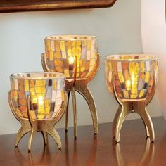 """Vienna Tealight Trio - Gold-painted stands elevate three mosaic glass cups for a striking vignette. Each mosaic piece is unique and one of a kind. Add a tealight, sold separately, for a brilliant effect. Trio includes one of each height: 5½""""h, 4¾""""h, 4""""h; 3¼""""w. http://www.partylite.biz/legacy/sites/nikkihendrix/productcatalog?page=productdetail&sku=P91631&categoryId=58466&showCrumbs=true #centerpiece #gold #glass #tile #partylite #candle #homedecor"""