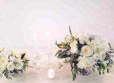 White centerpieces, rustic yet modern with clear tapers