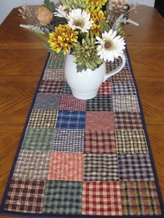 use the leftover fabric scraps from the boys' quilts and make a table runner. Patchwork Table Runner, Table Runner And Placemats, Table Runner Pattern, Quilted Table Runners, Farmhouse Table Runners, Colchas Quilting, Machine Quilting, Quilting Projects, Plaid Quilt
