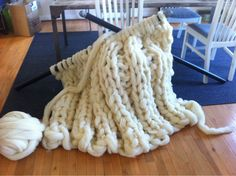 In 2011, I decided to knit something giant. First, I bought six pounds of unspun wool roving, then I went to the hardware store and bought broomsticks to act as knitting needles. When the broomsticks were too small, I went back and bought 1.5