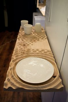 """CNC routed reaction shelf---""""I designed a shelf using one of our reaction-diffusion programs that had specific spaces where the porcelain prototypes of our new dinnerware line could rest. I think it came out well! The wood is cheap pine bought at our local hardware store."""""""