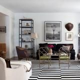 Interior designer Nate Berkus kept both of these facts in mind when he planned a careful renovation of the condo after purchasing it in 2003. The designer upgraded the home's hardwood floors, electrical wiring, appliances and air conditioning, all while maintaining its original details and elements of the mid-century remodel.