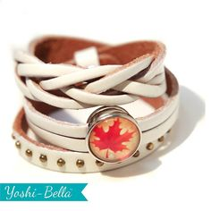 """Can you find the spelling mistakes?  Canada is 150 years young in 2017. Show your national pride for your favourite country with a stylish Canada snap medallion on a crisp white genuine leather wrap bracelet adjusts to fit most wrists.  Other colours available.  And by the way there are no spelling mistakes. That's right - colour and favourite is spelled with a """"u"""" here folks."""