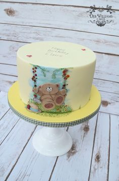This Forever Friends themed cake features the Forever Friends Bear on a flower adorned swing. Made by Deb Williams Cakes