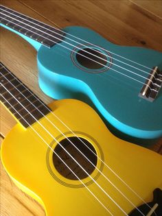 My new shimmery turquoise ukulele and my loaned yellow one! Learning dodie's songs