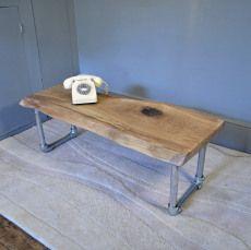 http://handmadeinbrighton.com/public/2015/04/gallery/minimalist-slab-oak-and-scaffold-coffee-table/