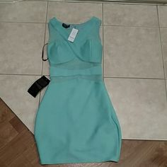 Bebe mesh dress NWT One hour sale!!!  NWT bebe metallic ottoman mesh dress. Size small in a greenish teal color. The model is wearing the small size as well and she is 5'10 and wearing the blue one. Stunning dress. You can dress it up or down bebe Dresses Midi