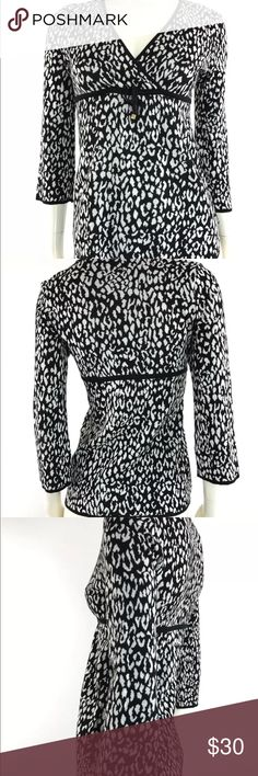 "Michael Kors Women's Petite Snow Leopard Blouse Michael Kors Women's Petite Snow Leopard Blouse  Size: Small Petite  Color: Black/White Design: Empire Tie Waist Sleeves: 3/4 Sleeves  Materials: 100% Cotton   Measurements (approximate) Length: 25"" Underarm to underarm (laying flat): 17""  Condition: Great pre owned condition. Missing other MK piece on string. See pictures for details. MICHAEL Michael Kors Tops Blouses"
