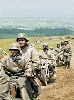 Motorcycle recon teams leading in front of a Panzer formation