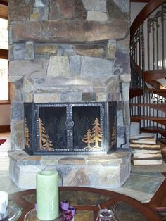 Stone Fireplace Remodel With Hand Forged Iron Doors