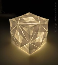 Sonobe Cube Lamp Tutorial  Sonobe variation, 24 units, Tracing paper  YouTube Tutorial: http://youtu.be/pFTfj2hkpts  Article to the design: http://origamitutorials.com/sonobe-cube-lamp-tutorial/