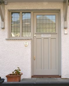 Minimalist style grey front door and frame with clear, leaded panes, hand-painted contemporary finish and chrome door furniture. Best Front Door Colors, Best Front Doors, Front Doors With Windows, Wooden Front Doors, Painted Front Doors, Glass Front Door, Cottage Front Doors, Front Door Porch, House Front Door