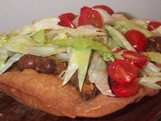 Navajo Tacos. This recipe is different than the other recipes posted in that it uses delicious homemade chili beans rather than canned.  You have to plan ahead to make this meal, and it takes a bit of work but it is well worth it! Its more of a special occasion meal and is very easily doubled for a larger crowd. My mom made these for us growing up-I think it is originally from Sunset Magazine.