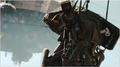 District 9 Image: alien mech powered armor suit looking at dropship Suit Of Armor, Moving Pictures, Camouflage, Sci Fi, Darth Vader, Movies, Fictional Characters, Workshop, Film