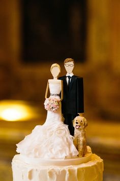 Adorable bride, groom + pup cake topper: http://www.stylemepretty.com/massachusetts-weddings/boston/2016/02/12/classic-wedding-at-the-boston-public-library/ | Photography: Joyelle West - http://jwestwedding.com/