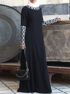 Gorgeous and unique, this modest embroidered dress doubles as a lightweight abaya for special occasions. From the delicate collar and sleeve detail to the floor-skimming skirt, the Habiba Dress is the perfect way to update your look. The intricate detailing and flattering fit make this dress a true addition to your modest wardrobe.