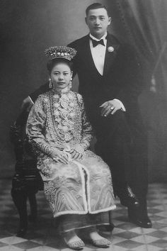 Nyonya in Traditional Dress, Baba in Western Dress Circa 1910s