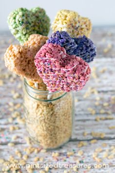 These heart-shaped rice krispie treat pops are the perfect, colorful treat for your next Valentines party! Wrap them up as gifts for a teach or neighbor!
