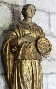 https://flic.kr/p/PXnDJb | St Lucy | Today is the feast of St Lucy, a Sicilian virgin martyr, c.304 who is believed to have been blinded before her execution. She is thus often shown holding a dish with her eyes on it!   My sermon for today can be read here.  This statue of the saint is in the chapel of the Lourdes chateau.