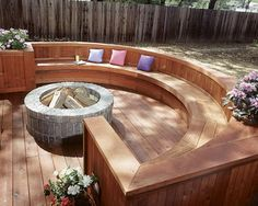 Conversation deck - brick fire pit built into a sunken deck and enclosed with a semicircular built-in bench.