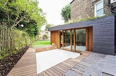 We didn't want just another glass box: RIBA award-winning extension Kitchen: The exterior of the extension is clad in timber and slate clad and the green roof is seeded with meadow flowers Extension Veranda, Glass Extension, Roof Extension, Extension Google, Extension Ideas, Roof Design, Exterior Design, Bungalow, Timber Cladding