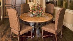 Transitional style dining room table & chairs with floral centerpiece decor