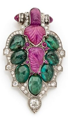 An Art Deco platinum, gold, diamond, ruby and emerald clip brooch, French, circa 1930. #ArtDeco #ClipBrooch