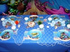 Tips to decorate for an Under the Sea party - I like the covered table and net over it