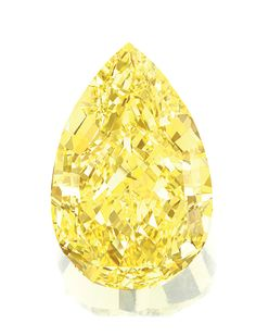THE SUN-DROP DIAMOND. The fancy vivid yellow pear-shaped diamond weighing 110.03 carats, mounted in yellow gold as a ring for presentation, size 52, accompanied by a wooden presentation box.