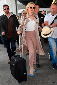 9 May Naomi Watts looked colourful in blush pink as she arrived in Nice. - HarpersBAZAAR.co.uk