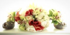 Wedding bouquet green orchids, mango calla lilies, white roses, elegant barn wedding