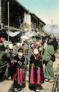 The rural poor of Japan often sold their girls at age five or six, to the sex trade. Kyoto, Japan,1906. Tayuu Douchuu (Courtesans' Parade). Prostitute with two child assistants.