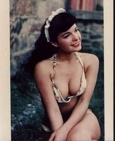 """She was the quintessential 1950's pinup girl, jet-black hair, sultry smile, flashing eyes, and a body that drove men wild. But, there was much more to Bettie Page than met the eye. Here is her story, from her small town beginnings to her worldwide acceptance as a pop culture icon. Watch """"Bettie: The Girl in the Leopard Print Bikini"""" for FREE."""
