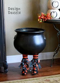 DIY witches feet cauldron to hold your Halloween candy.