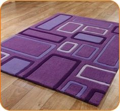 Purple color rug with creative modern design specially designed for kids room.