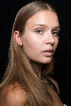 It was nearly 1,000 degrees backstage at Tommy Hilfiger, so the models' glow was half sweat, half moisturizer.