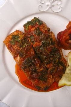 """CHREIME (fish stew) ~~~ chreime is a traditional fish stew that is popular throughout north africa and the jewish community. the sauce is fiery rich and is most often seen utilizing white fish. recipe gateway: this post's link AND http://www.sassyradish.com/2013/05/spicy-tunisian-fish-stew-chreime/ AND a recipe shared from the book, """"'the book of new israeli food"""" http://thespiceadventuress.com/2013/10/14/chreime-north-african-fish-stew/ [Tunisia] [charlotteauchocolat] [Janna Gur]"""
