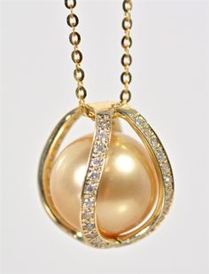 Golden South Sea Pearl In Diamond And Yellow Gold Cage.......
