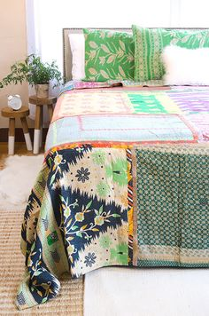 $250 Hand-sewn Queen Kantha Quilt crafted by Artisans in India. The vintage fabric comes from misprints, selvedge or even damaged fabrics that were rejected due to imperfections.