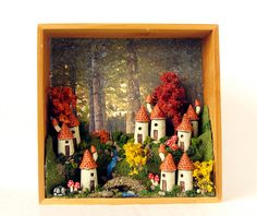 Autumn Fairy Village on the Wall - Edition 7 -  Nine French Country Fairy Houses with Stone Bridge, Trees and Mushrooms by Bewilder and Pine. $89.00, via Etsy.
